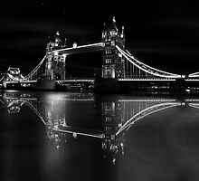 a tale of two bridges - a stunning and unique black & white print with London Tower Bridge lit and beautifully reflected in the River Thames by blueskyjunction