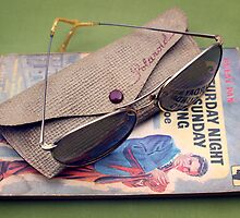 Polaroid Sunglasses and Paperback  by AndyLanhamArt