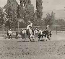 Jack Wade Bulldogging In The 1945 Reno, Nevada Rodeo by Robert Stanford