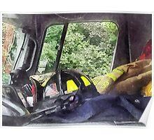 Firemen - Helmet Inside Cab of Fire Truck Poster