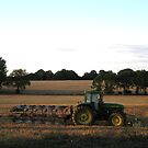 Tractor and plough at end of day by KatDoodling