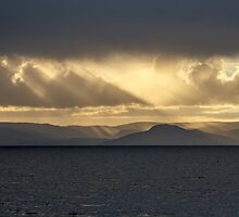 Setting sun over the Isle of Arran by AyrshireImages