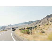 Camper Van Driving Through Dry Landscape Photographic Print