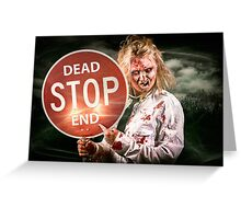 Halloween portrait. Scary zombie holding stop sign Greeting Card