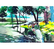 Cycle in puddle Photographic Print