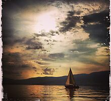 Sailing boat at sunset by Christophe Besson