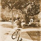 boy on bike by A.R. Williams