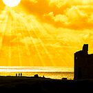 people at ballybunion castle at sunset by morrbyte
