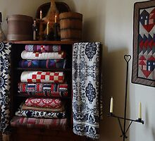 Quilts stacked high by vigor