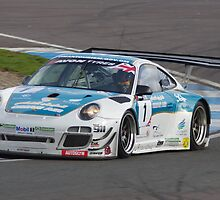 British GT 2013 Donington - #1 Ahmad Al Harthy / Michael Caine - Oman Air Motorbase Porsche 997 GT3 R - Exiting Fogarty Esses by motapics