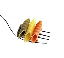 italian penne pasta on a fork ,on white background by keko64