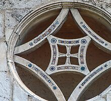 Rose window on facade San Pietro Spoleto 198404090050 by Fred Mitchell