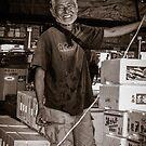 Fish Market Worker by Colin  Ewington