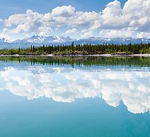 Yukon wilderness cloudscape reflected on calm lake by ImagoBorealis