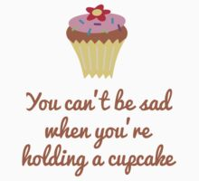 You can't be sad holding a cupcake by artack