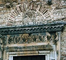 C4 C5 stonework over doorway San Salvatore Spoleto 198404100016  by Fred Mitchell