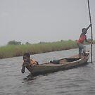 Boys on Boat- Ghana by TravelGrl