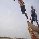 Ghana boys jumping off boat by TravelGrl