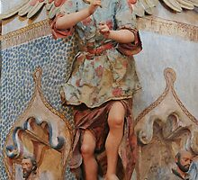 Angel with sculptures at Mission San Xavier by ozwille