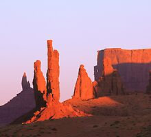 Monuments at Sunset, Monument Valley, Arizona by Roupen  Baker