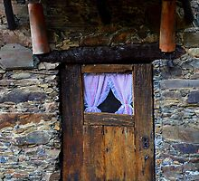 Wooden door with curtains in schist cottage by juliedawnfox