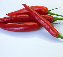 Red hot spicy peppers for you by John Westerveld