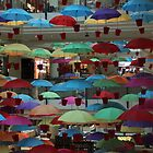 Umbrellas in the sky by Trevor Corran