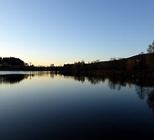Indian summer sunset at the fishing lake IV | waterscape photography by Patrick Jobst