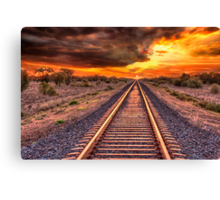 Train track to sunset Canvas Print