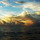 Maldivian sunset over the sea by Siegeworks .