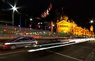 Flinders St station after dark by collpics