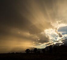 Light Rays Over Teton Mountains by cavaroc
