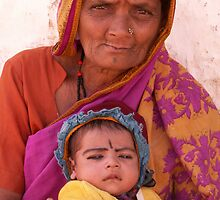Grandmother and child in Badami, India by indiafrank