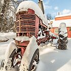 Vintage Farmall Tractor in the Snow by Edward Fielding