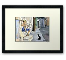 Boy playing flute for cat Framed Print