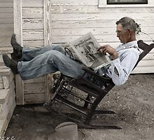 Farmer reading his newspaper, Texas. by PhotoRetrofit