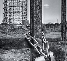 Industrial black and white architecture and chained gate - La Roma che non vedi by visionitaliane