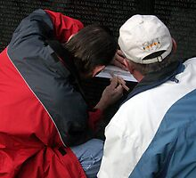 Rubbing A Veteran's Name by Cora Wandel