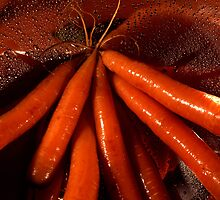 Tasty moist carrots in a colander by intensivelight