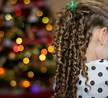 Child looks towards Christmas Tree by stuart renneberg