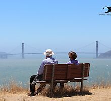 Couple enjoying a view of the Golden Gate Bridge by 2Canons