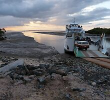 A ferry and mudflats by PhotosByG