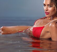 Young glamorous woman in red bikini lying in water art photo print by ArtNudePhotos