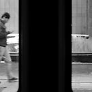 Man Walking with a Cell Phone by Mark Jackson
