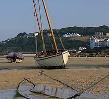 Boat on beach at low tide by Brooxi