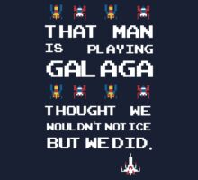 That Man is Playing Galaga! by Mike Pitcher