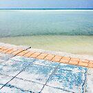 Colorful Sidewalk Near Tropical Ocean by visualspectrum