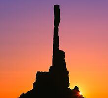 Totem pole at sunrise in Monument Valley by Henk Meijer