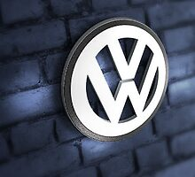 Vw Badge on an old blue wall by jay007