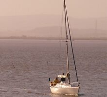 Yacht returning to the estuary, Burnham-on-Sea. by Antony R James
